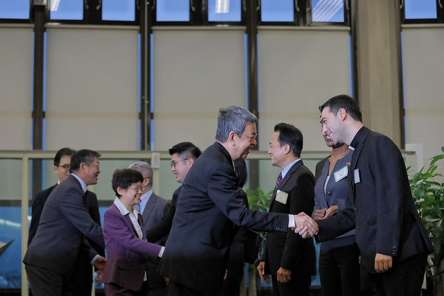Vice President Chen shakes hands with people on hand to greet him.