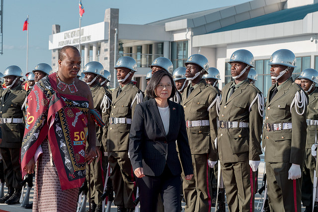 Swaziland's King Mswati III accompanies President Tsai in a red-carpet review of a military honor guard.