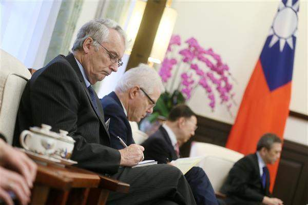 Members of the delegation led by former US Secretary of Defense William J. Perry take notes during the meeting with President Tsai.