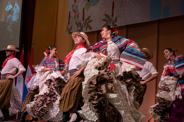 A folk dance troupe performs at a banquet for representatives of the expatriate community in Paraguay.