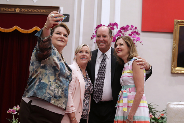 The guests in attendance at the medal-conferring ceremony take selfies.