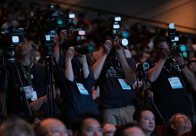 Media photographers take photos at the 2017 World Congress on Information Technology.