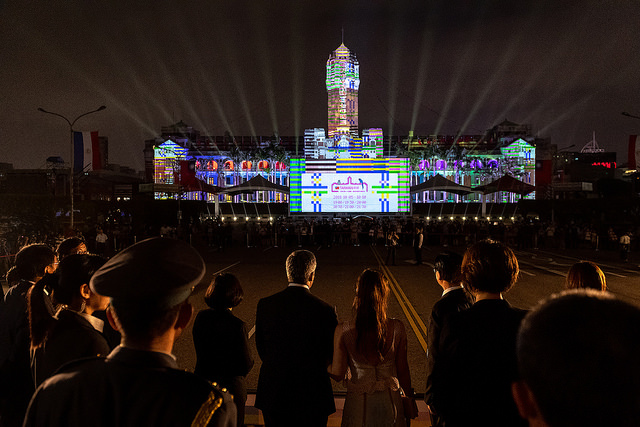 Paraguayan President Mario Abdo Benítez and his wife see the projection mapping show in front of the Presidential Office Building.