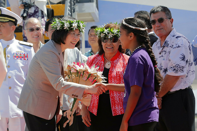 President Tsai accepts flowers from local children.