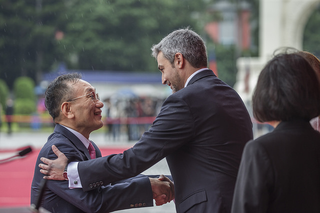 Paraguayan President Abdo shakes hands with the distinguished guest.