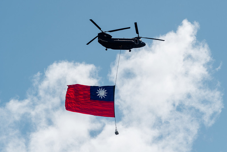 Helicopters carry the Republic of China flags as they fly over the Presidential Office building.
