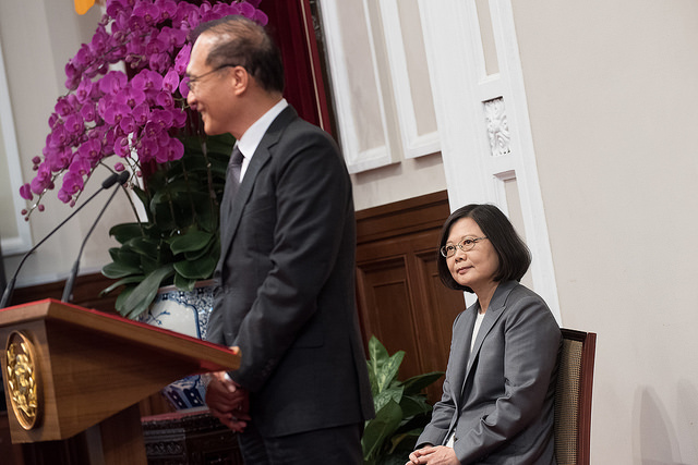 President Tsai listens to remarks delivered by Premier Lin Chuan.
